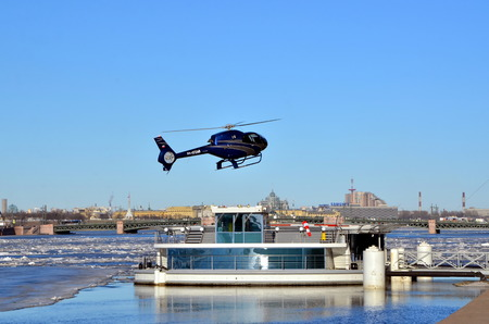 helipad: Jetty and helipad on the Admiralty Embankment in St. Petersburg. Helicopter lands Editorial
