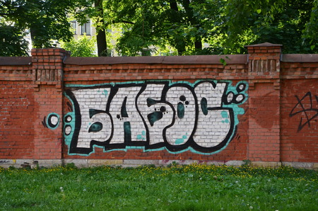 tagging: Graffiti tagging on a brick wall in SaintPetersburg Russia Editorial