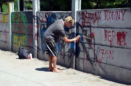 Graffiti artist draws a picture on the wall on the island of Gili Trawangan Indonesia