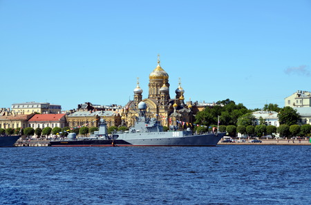 anti season: The small anti-submarine ship Zelenodolsk on the background of church of Assumption of Blessed Virgin Mary. The celebration of the Navy, St. Petersburg