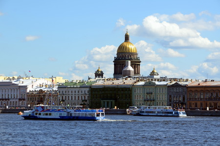 historically: Tourist boats on a background of the English Quay in Saint Petersburg. It has been historically one of the most fashionable streets in Saint Petersburg Editorial