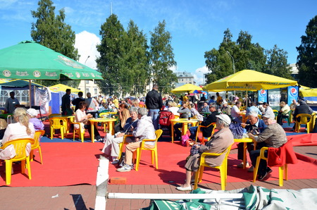 visitors: Agricultural Fair in St. Petersburg. Visitors sit in outdoor cafes Editorial