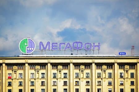 gsm: Megafon logo on the facade of the building. MegaFon previously known as North-West GSM is the second largest mobile operator in Russia