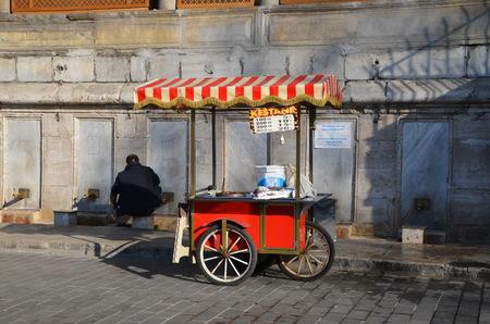 mohammedan: Mohammedan prayer. Seller of bagels performs ablutions before prayer. Istanbul, Turkey