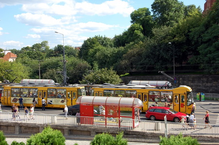 trams: Bright yellow trams in Warsaw, Poland