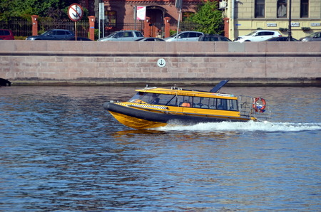 cast off: Aquabus on the Neva River, St. Petersburg, Russia. Aquabus is regular transport in St. Petersburg from May to October