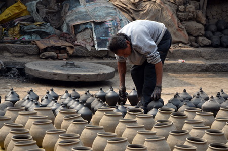 lays: Potter lays just made amphoras. Bhaktapur, Nepal