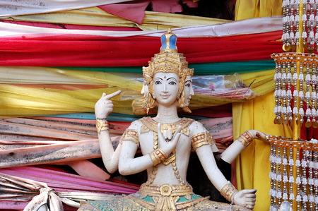 Ancient sculpture of Hindu deity Trimurti in Vientiane, Laos