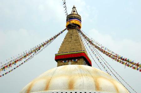 Bodnath stupa with Buddha eyes and prayer flags in Kathmandu, Nepal