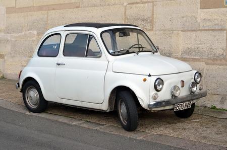 fiat: White retro Fiat on the street in Paris
