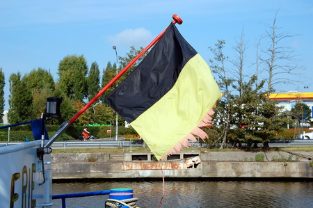 tear duct: Faded and torn Belgian flag