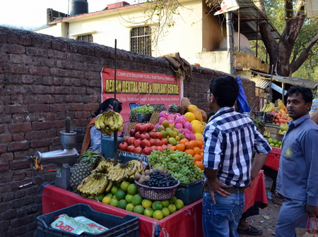 hindus: Hindus buy fruit at small fruit stall in Rishikesh, India