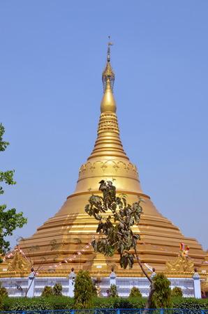 gautama buddha: Huge golden buddhist stupa in Kushinagar, India. It is important Buddhist pilgrimage site, where Buddhists believe Gautama Buddha attained Parinirvana after his death