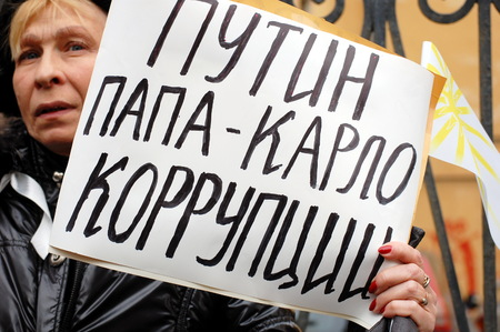 father in law: SAINT-PETERSBURG, RUSSIA - FEB 25, 2012 - Rally for Fair elections in Russia. St. Petersburg, 25.02. 2012. A woman holds banner: Putin is father of corruption!