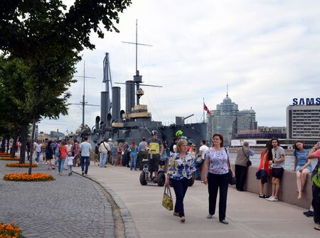 cruiser: SAINT-PETERSBURG, RUSSIA - JULY 17, 2016: A lot of tourists at the cruiser Aurora, St. Petersburg, Russia