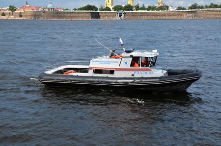 Boat of search and rescue services on the Neva River, St. Petersburg, Russia