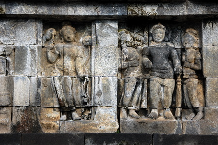 stone carvings: Ancient stone carvings are around Borobudur site. Borobudur, or Barabudur, is a 9th-century Mahayana Buddhist Temple in Magelang, Central Java, Indonesia Stock Photo