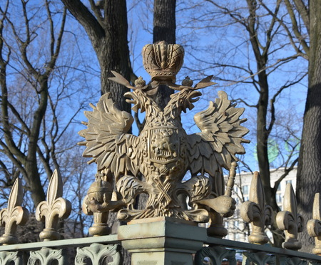 double headed eagle: The double-headed eagle. Fragment of the lattice around the house of Peter I, St. Petersburg. The sculpture was built in 1852 Editorial