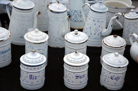 bruges: Flea market in Bruges, Belgium. Old enameled dishes Stock Photo