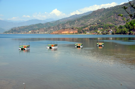 phewa: Four catamaran boats  on the Phewa lake  in Pokhara, Nepal Stock Photo