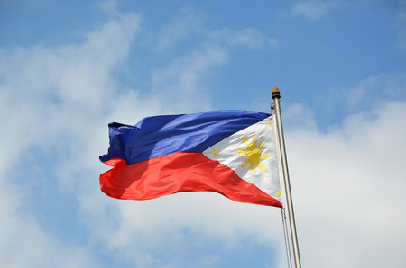 National flag of Philippines on the sky background Stock Photo
