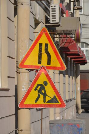 Temporary road signs: Narrowing the road and Road works Stock Photo