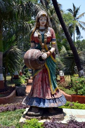 Girl with a jug.  Sculpture in Mumbai, India