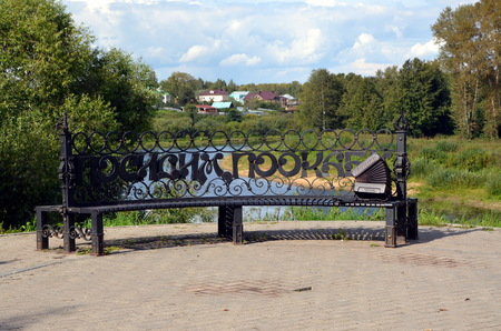 Art object in Vologda, Russia. Cast-iron bench with an accordion on the embankment of the Vologda River Editorial