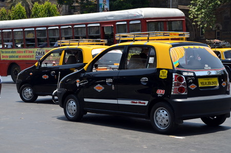 MUMBAI, INDIA - MAY 18,  2013 - New  black and yellow Mumbai taxi Editorial