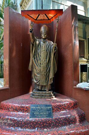 scepter: MUMBAI, INDIA - MAY 18, 2013 -  Monument to Pope John Paul II in front of Roman Catholic Holy Name Cathedral. Mumbai (Bombay), India