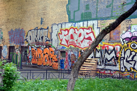 Brick wall painted with graffiti in St. Petersburg