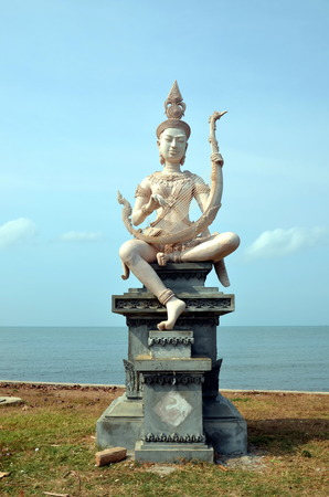 Embankment in Kep, Cambodia. Beautiful buddhist statue on the bank of the sea Stock Photo