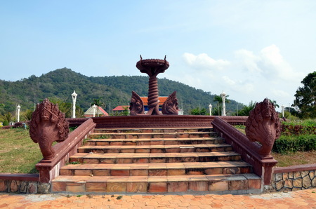 Fountain with cobras in Kep town, Cambodia Editorial