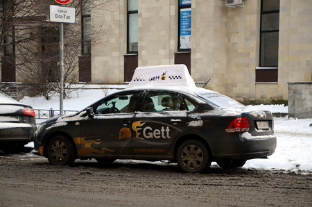 ST-PETERSBURG, RUSSIA - JAN 8, 2018: Gett Taxi. Gett, previously known as GetTaxi, is a global on-demand mobility company that connects customers with transportation, goods and services