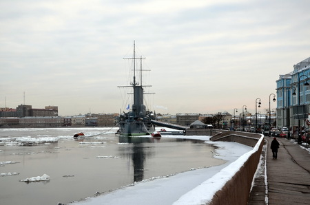 SAINT-PETERSBURG, RUSSIA - JAN 14, 2014 - View on legendary Aurora cruiser in winter day, St. Petersburg, Russia