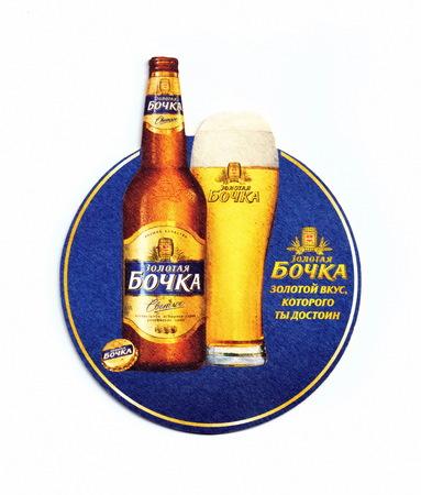 ST-PETERSBURG, RUSSIA - MAY 18, 2017 - Coaster (beer mat) advertising beer  Golden Barrel