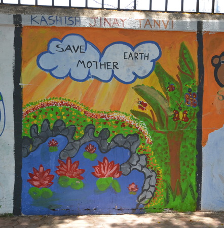 Save Mother Earth! Children`s drawing on the wall in Mumbai, India