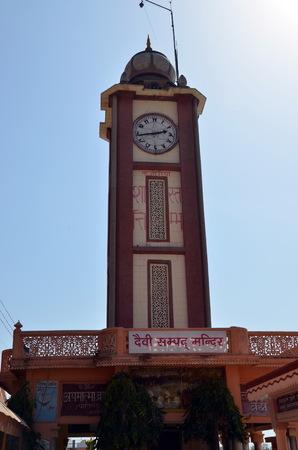 RISHIKESH, INDIA - APRIL 7, 2013 - Clock tower in holy Indian city Rishikesh