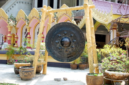 Huge prayer gong in a Buddhist temple, Thailand