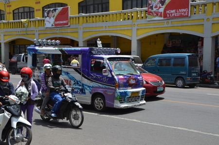 CEBU CITY, PHILIPPINES - MAY 20, 2016 - Transportation in Cebu, Philippines. Jeepneys, sometimes called simply jeeps, are the most popular means of public transportation in the Philippines Stock Photo - 126073372