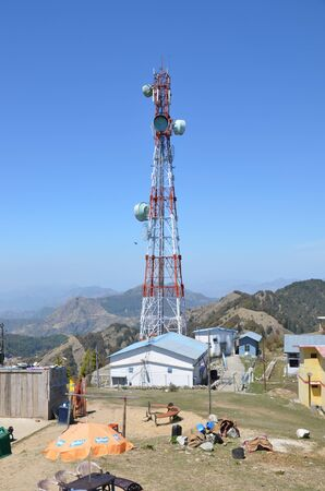 RISHIKESH, INDIA - APRIL 8, 2013 - Radio tower in the Himalayan mountains, India