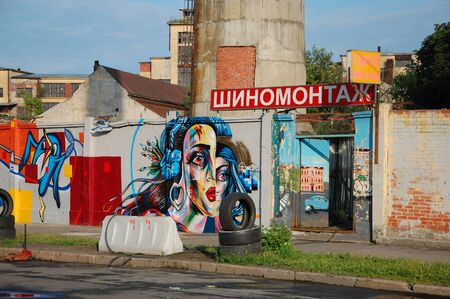 ST-PETERSBURG, RUSSIA - JULY 11, 2013: Car service, painted with graffiti in St-Petersburg