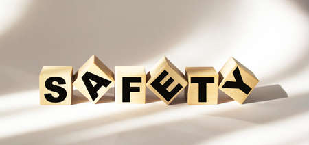 safety word written on wood block. safety text on wooden table for your desing, concept. 스톡 콘텐츠