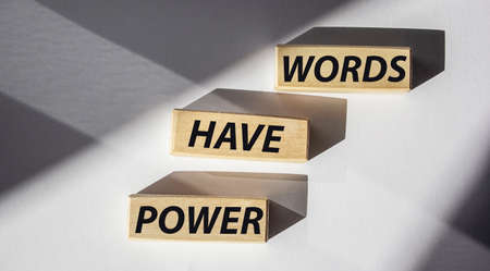 Words have power written on wooden cubes and white background