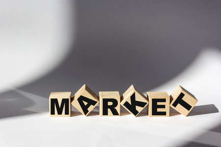 Market word written on a wooden block. Marketing text on a white table for your design. Business commercial concept. 스톡 콘텐츠