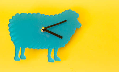 Time management concept: vintage turquoise sheep watch