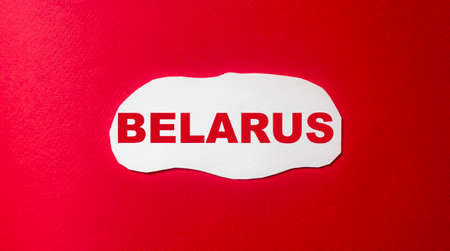 Belarus, word written on a white piece of paper and a red background