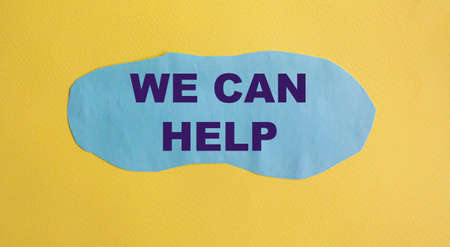 We can help you. Text on blue piece of paper and yellow background