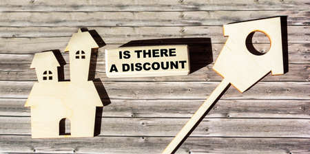 Is there a discount, the text is written on a wooden block, the mock-ups of the houses lie on brown boards