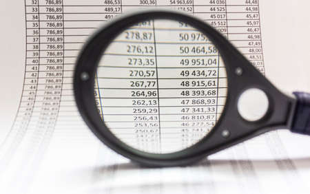Business chart with magnifying glass, business workplace